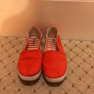 Red canvas shoe with frayed detail